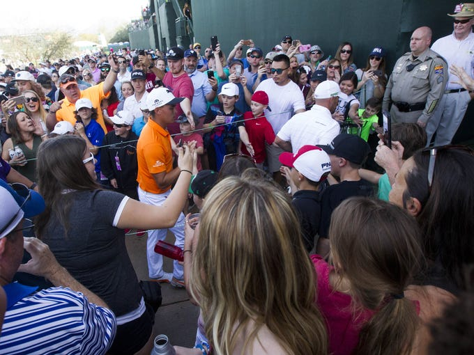 Rickie Fowler enters the tunnel leading to the 16th