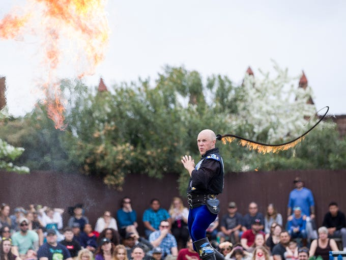 Adam Crack performs a fire-whip show during the Arizona