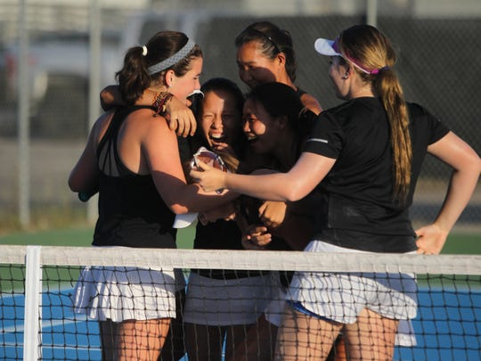 The Chiles girls tennis team celebrates after winning a regional title to advance to the state tournament for the second straight season.