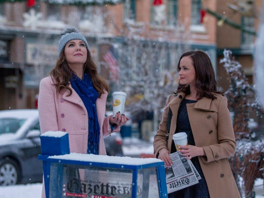 Lorelai Gilmore (Lauren Graham) and daughter Rory (Alexis Bledel) contemplate their quirky Connecticut town in Netflix's 'Gilmore Girls: A Year in the Life.'