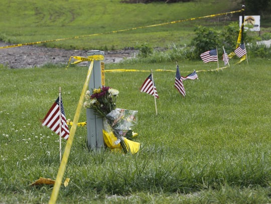A neighbor placed flowers outside a Clinton County