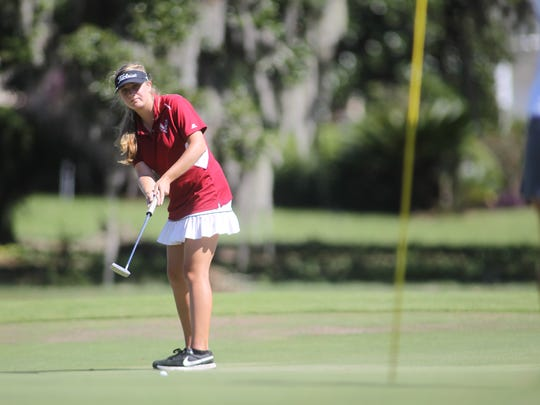 Franklin County's Melanie Collins watches her putt on Southwood's hole No. 18.