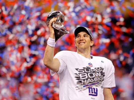 Giants quarterback Eli Manning holds the Vince Lombardi