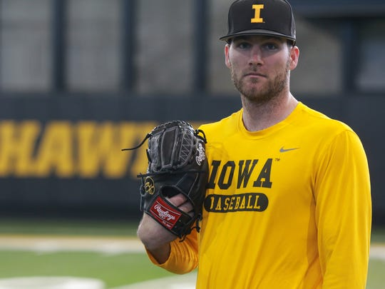Iowa pitcher Nick Allgeyer poses for a photo before practice at the indoor practice facility on Thursday, Feb. 1, 2018.