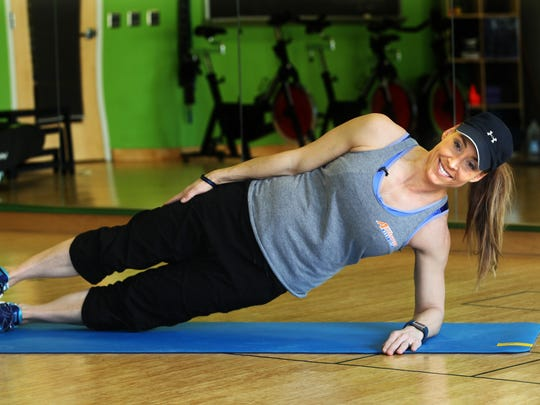 Catherine Andersen, owner and personal trainer of Adventure Boot Camp and Achieve Personal Fitness at Balance Fitness demonstrates the ending position for the side plank with hip dip exercise.