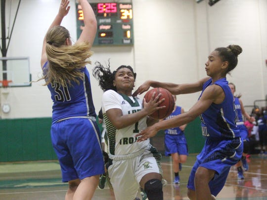 Erica Turral drives to the basket and is fouled during