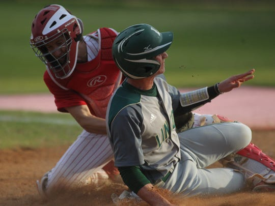 Leon catcher Bryce Palmer receives a throw from right fielder Japhen Knight and tags out Lincoln's Beau Evans at the plate.