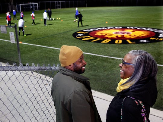 Fred Gayle and Soncera pause at their son's Austin soccer practice. It is a challenge for the Gayles to fit in their own workouts with their three children's busy schedule.