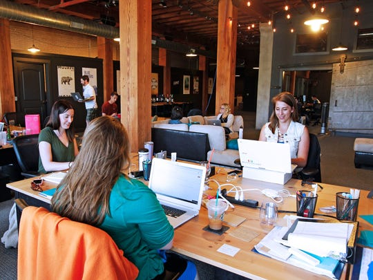 Wine concierges Sam Collins (left), Lucy Koshewa and Amanda Hollinger (back to camera), communicate with customers online at Bright Cellars, a Milwaukee-based monthly wine club. Wine lovers are hoping the Delaware Legislature will reform a law that prohibits residents from receiving out of state wine through the mail.