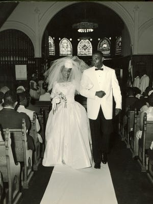 Betty McClenny's wedding in the Scottsville Episcopal Church. Her dress and photo album are on display at the Big Springs Museum.