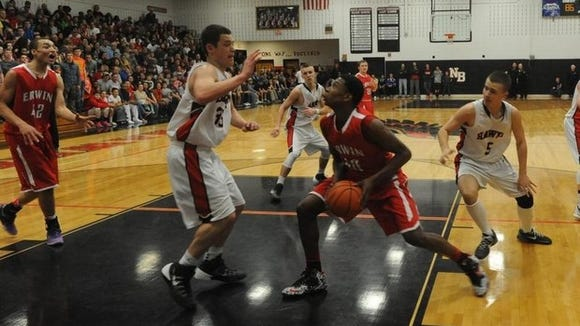 Erwin's Jeremiah Jackson prepares to go up for a shot in last season's game at North Buncombe.