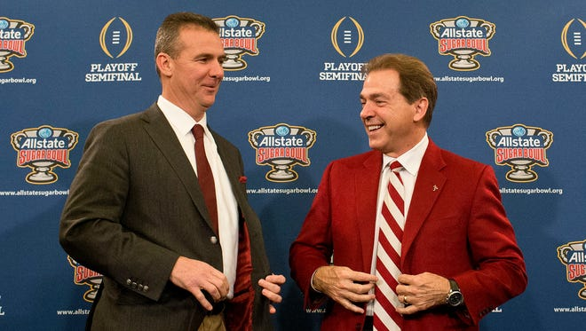 Ohio State coach Urban Meyer, left, and Alabama coach Nick Saban laugh during a press conference at the Marriott downtown convention center in New Orleans on Dec. 31, 2014.