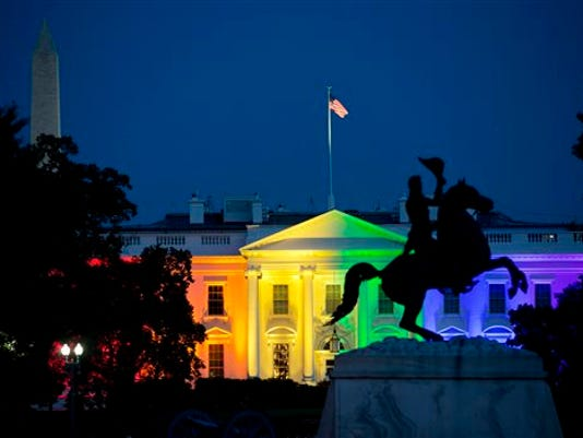 The White House is lit up in rainbow colors in commemoration of the Supreme Court's ruling to legalize same-sex marriage Friday, June 26, 2015, in Washington. Gay and lesbian couples in Washington and across the nation are celebrating Friday's ruling, which will put an end to same-sex marriage bans in the 14 states that still maintain them.