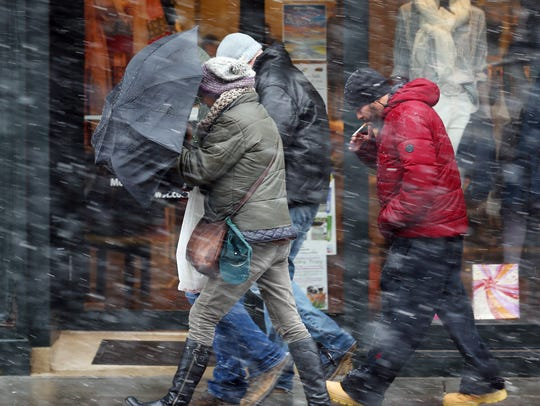 People walk down South Street in Morristown braving