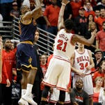 Cleveland Cavaliers' LeBron James, left, shoots the game-winning shot against Chicago Bulls guard Jimmy Butler during the second half of Game 4 in a second-round NBA basketball playoff series in Chicago on Sunday, May 10, 2015. The Cavaliers won 86-84. (AP Photo/Nam Y. Huh)