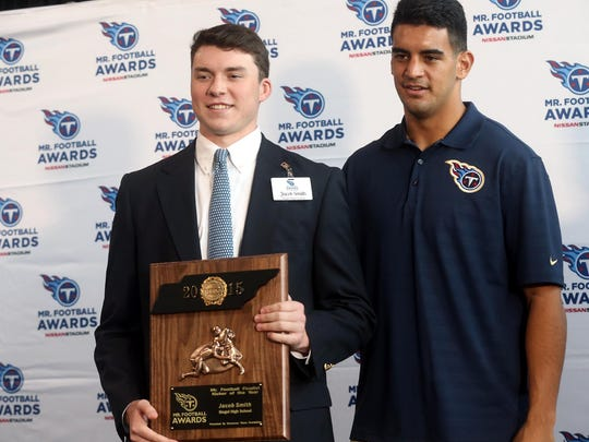 Siegel's Jacob Smith, left holds his runner-up award for Kicker of the Year after receiving the award from Tennessee Titans quarterback Marcus Mariota at the Tennessee Titans Mr. Football Awards at Nissan Stadium this month..