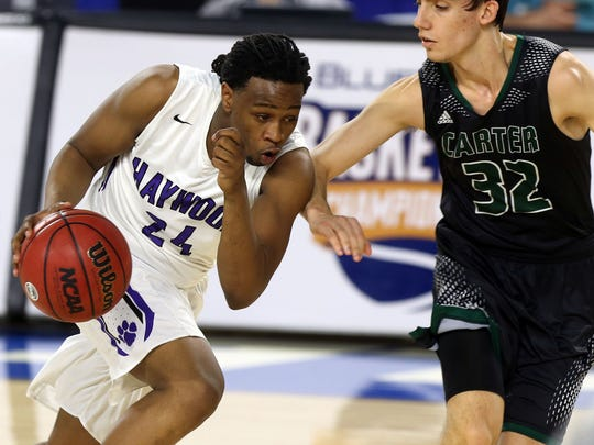 Haywood's Alandis Delk dribbles up the court against Carter's Austin Hayes in the first half Thursday in the Class AA state quarterfinals at MTSU.