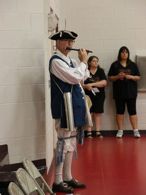 Jan Huber, from the Saguaro Chapter of the Arizona Society of the Sons of the American Revolution, plays the fife in the Honor Guard.