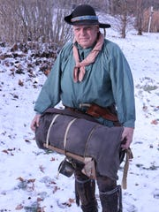 Mel Stafford, a re-enactor dressed 18th century style,