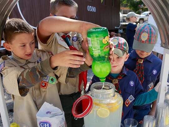 Members of the Boy Scouts of America Troop 325 and Cub Scouts Pack 325 were serving lemonade and Fritos chili pie during Founders Day on Saturday at the Aztec Museum & Pioneer Village. From left are Colby Smith, 9; Barrett Smith, 12; Jacob Costen, 9; and Zachary Shaw, 9.