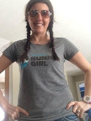 "Heather Johnson Durocher, 40, of Traverse City penned an essay published in ""Tales From Another Mother Runner."""