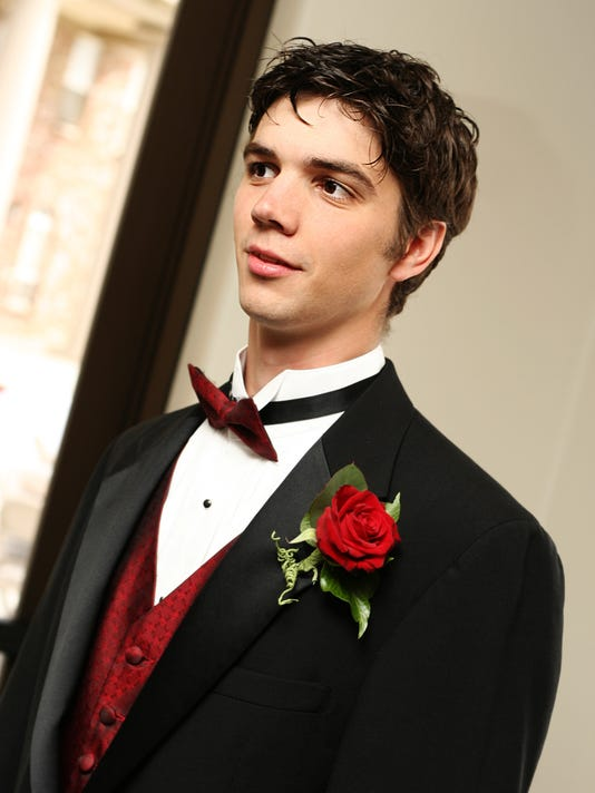 Young Groomsman at a Wedding