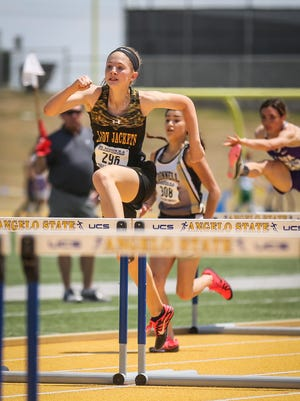 Menard's Alee Hensley competes in the 100-meter hurdles during the Region II-1A Track Meet Saturday, April 28, 2018, at Angelo State.