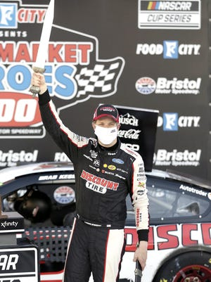 Brad Keselowski (2) celebrates after winning a NASCAR Cup Series auto race at Bristol Motor Speedway Saturday, May 30, 2020, in Bristol, Tenn.