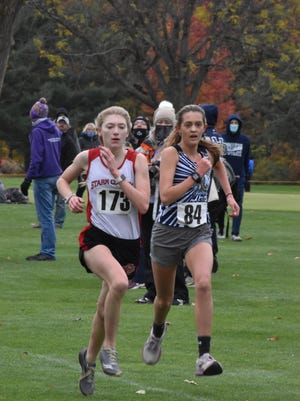 Mercer County's Eden Mueller, right, races Stark County's Alyssa Dyken to the finish line of the IHSA Class 1A cross country regional on Saturday, Oct. 24, at Saukie Golf Course in Rock Island. Mueller finished eighth with a time of 19:41.7.
