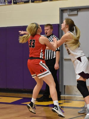 Orion's Maryn Bollinger wrestles with a Rockridge defender during regional action on Feb. 10 in Sherrard.