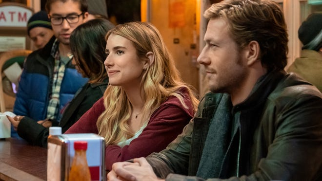 "Emma Roberts as Sloane Reed and Luke Bracey as Jackson in ""Holidate."""