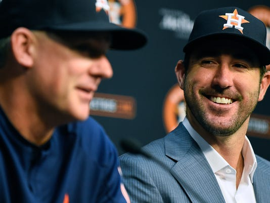 Houston Astros pitcher Justin Verlander, right, listens to manager A.J. Hinch during a press conference introducing Verlander before a baseball game against the New York Mets, Sunday, Sept. 3, 2017, in Houston. Verlander was traded to Houston from the Detroit Tigers on Thursday. (AP Photo/Eric Christian Smith)