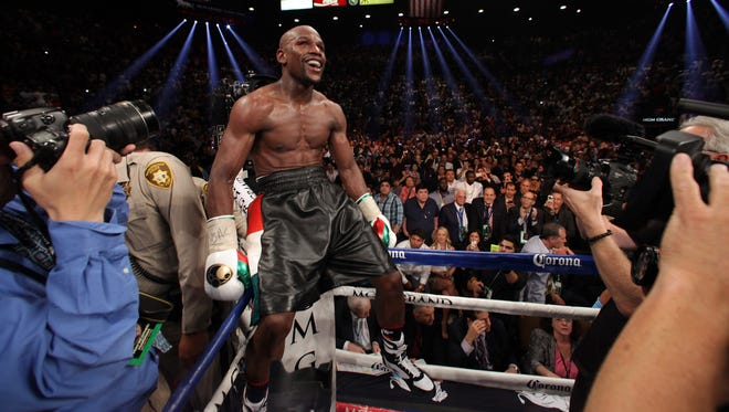 Floyd Mayweather Jr. celebrates his win over Marcos Maidana late Saturday at The MGM Grand, Las Vegas.