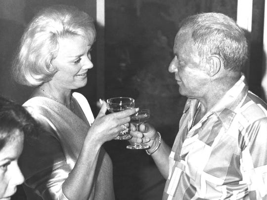 Frank Sinatra and new bride, the former Barbara Marx, toast each other at a reception following their wedding on Sunday, July 12, 1976 in Palm Springs, Calif. The event took place at the estate of former ambassador Walter Annenberg. (AP Photo)