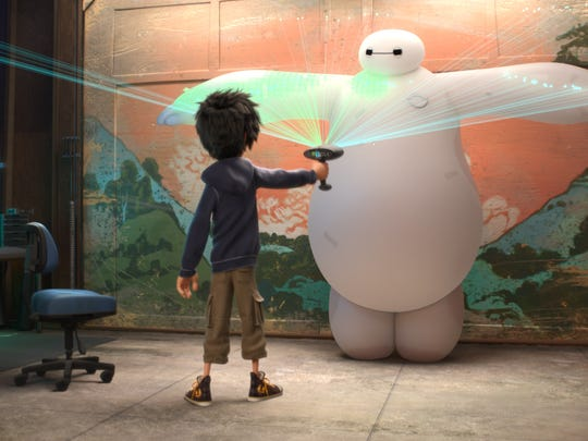 """This image released by Disney shows animated characters Hiro Hamada, voiced by Ryan Potter, left, and Baymax, voiced by Scott Adsit, in a scene from """"Big Hero 6."""" (AP Photo/Disney)"""