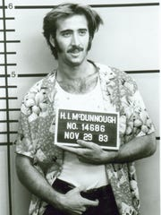 "Convenience store bandit Hi McDonnough (Nicholas Cage, pictured) falls in love with Ed (Holly Hunter), the lady cop who keeps taking his mug shot in ""Raising Arizona."""