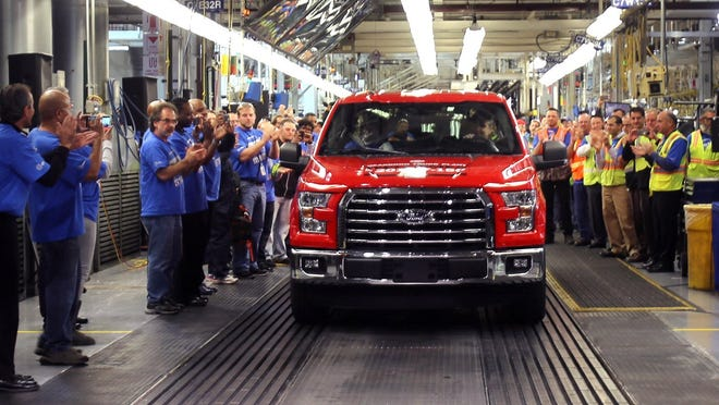 The first all-new 2015 Ford F150 truck comes off the assembly line at the Dearborn Truck Plant at the Ford Rouge Centeron November 11, 2014 in Dearborn, Michigan.