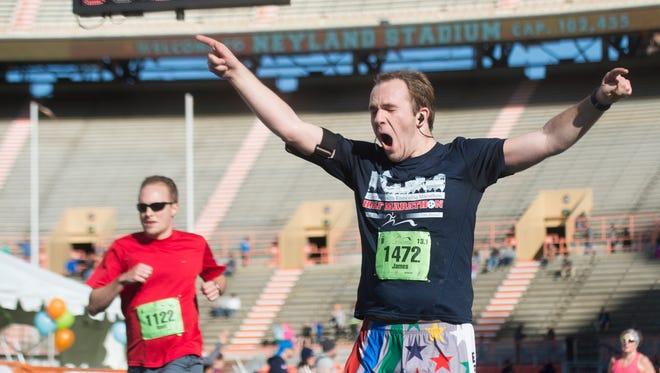Jame Dow celebrates after finishing the half marathon of the Knoxville Marathon on Sunday, April 2, 2017.