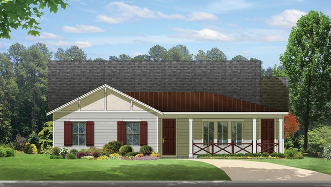 A wraparound porch adds friendly curb appeal to this ranch home. Note how the garage faces the side of the home instead of the front – an aesthetically pleasing choice.