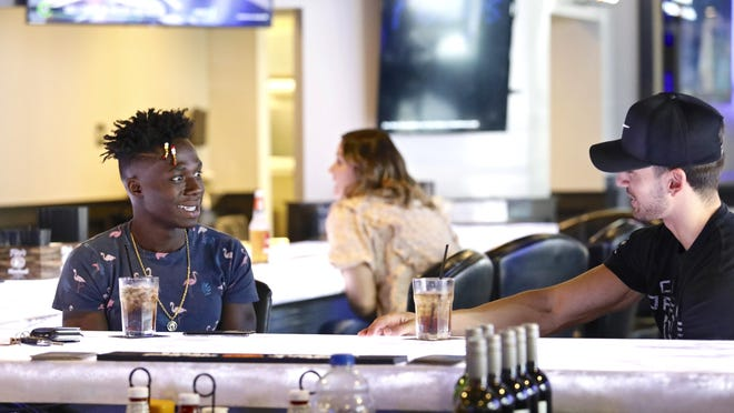 Joey Malavolti, left, of Chicago, and Tyler Malk of Rockford talk over drinks on Friday, Oct. 9, 2020, at Fozzy's Bar and Grill in Loves Park.