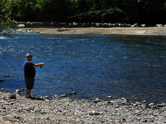 Mark West casts while fly fishing on the Santiam River at North Santiam State Park, on Monday, June 22, 2015, near Lyons, Ore. Afternoon fishing will be closed down on many Oregon rivers beginning Saturday, and will be closed entirely on some streams due to the ongoing drought and high water temperatures.