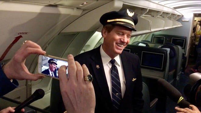 United Airlines Captain David Smith laughs during an interview aboard Flight 2704 Friday at Chicago O'Hare International Airport.