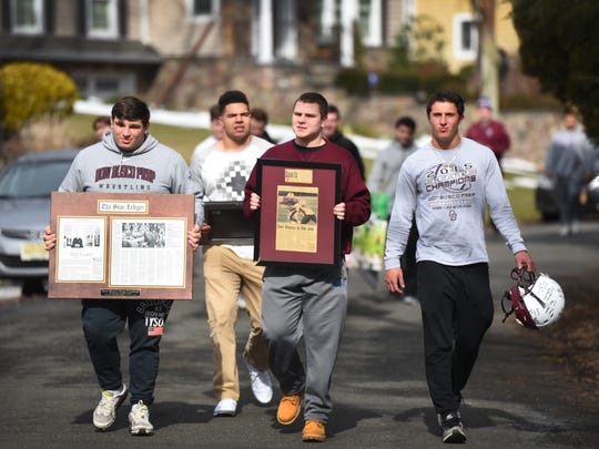 A group of current  Don Bosco Prep football players are seen carrying some belongings of their former coach Greg Toal's to his house on Sunday morning as a show of support for their coach, who they feel was wrongly forced to resign by school officials. Photographed in Wyckoff on Feb. 19th, 2017.
