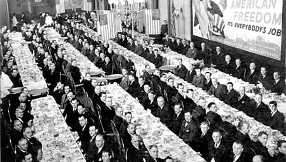 Executives sit down for a meal during World War II