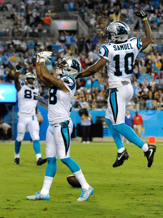 Carolina Panthers' Damiere Byrd (18) celebrates his touchdown catch against the Pittsburgh Steelers with Curtis Samuel (10) in the first half of an NFL preseason football game in Charlotte, N.C., Thursday, Aug. 31, 2017. (AP Photo/Mike McCarn)