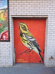 Artist ATM painted this mural of a Townsend's warbler