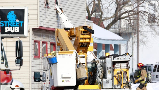 Wausau Fire Department and Wisconsin Public Services respond to a building fire Monday morning on North Sixth Street in Wausau.