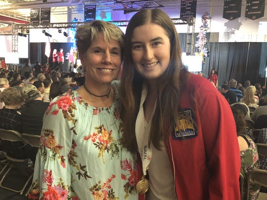 Pictured from left to right, Polytech instructor Cynthia Dailey congratulates her graphic design student Hailey Gettel on winning a gold medal in the T-Shirt design category at SkillsUSA.