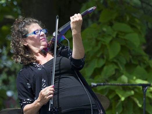 Cathy Morris, violinist, performs on her 7-string electric