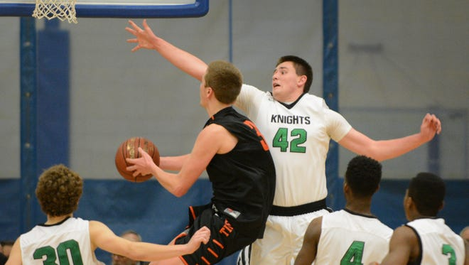 Ripon guard Eddie Muench gets through the Dominican defense and past Ben Jelacic to score.